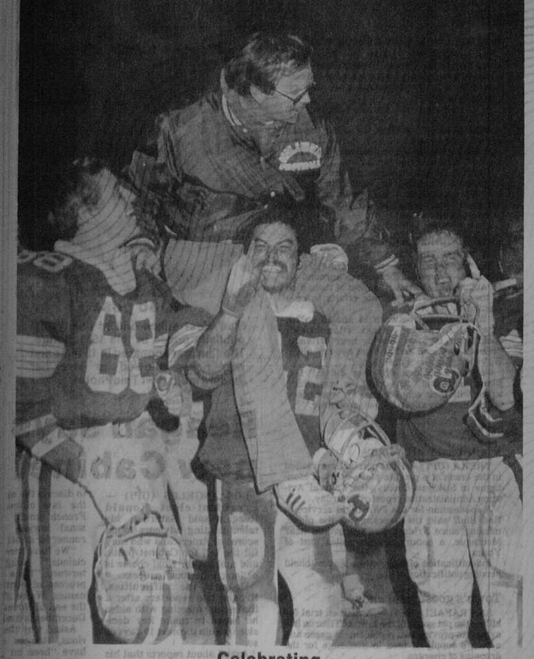 After 1980 CIF title game, Head Coach Tom Johnson is on Robert Holshers shoulders, and to the right #34 Kevin Wallace, to far left  John Botch.